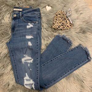 Levi's Strauss 711 skinny distressed raw hem jeans